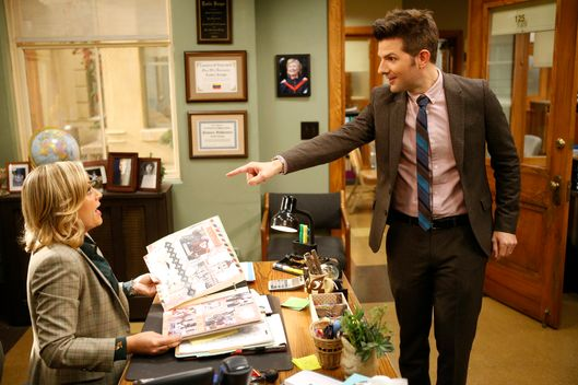 "PARKS AND RECREATION -- ""Anniversaries"" Episode 614 -- Pictured: (l-r) Amy Poehler as Leslie Knope, Adam Scott as Ben Wyatt -- (Photo by: Jordin Althaus/NBC)"