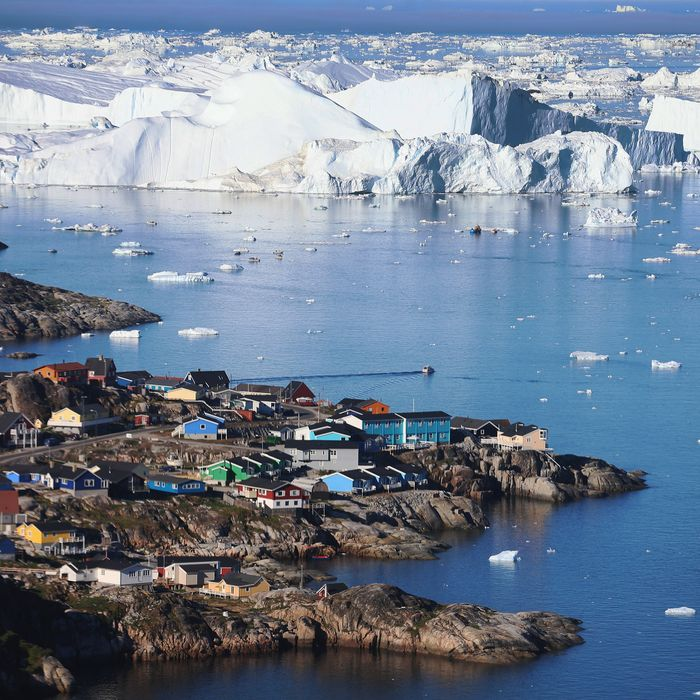 The village of Ilulissat is seen near the icebergs that broke off from the Jakobshavn Glacier on July 24, 2013 in Ilulissat, Greenland.