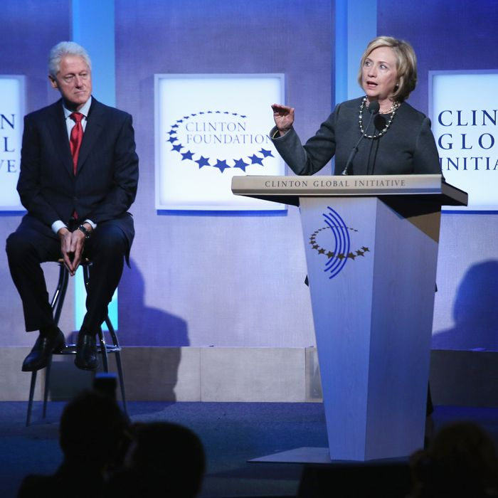 NEW YORK, NY - SEPTEMBER 22: Former U.S. Secretary of State Hillary Clinton (R) speaks as former U.S. President Bill Clinton looks on during the opening plenary session of the Clinton Global Initiative (CGI), on September 22, 2014 in New York City. The annual meeting, established in 2005 by President Bill Clinton, convenes global leaders to discuss solutions to world problems. (Photo by John Moore/Getty Images)