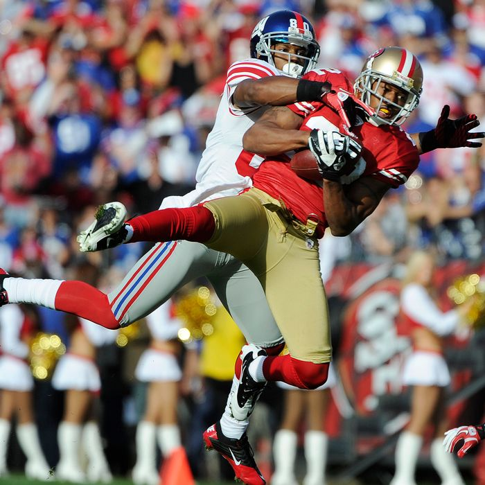 Carlos Rogers #22 of the San Francisco 49ers intercepts the pass in front of Victor Cruz #80 of the New York Giants during an NFL football game at Candlestick Park November 13, 2011 in San Francisco, California.