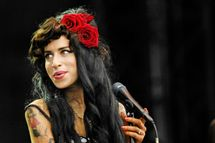 UNITED KINGDOM - AUGUST 16:  V FESTIVAL  Photo of Amy WINEHOUSE, Amy Winehouse performing on stage  (Photo by Mark Holloway/Redferns)