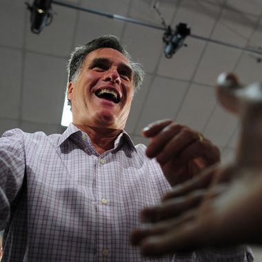Republican presidential hopeful Mitt Romney greets supporters as he holds a campaign rally at Emma Lou Olson Civic Center in Pompano Beach, Florida, January 29, 2012. Florida will hold its Republican primary on January 31, 2012. AFP PHOTO/Emmanuel Dunand (Photo credit should read EMMANUEL DUNAND/AFP/Getty Images)