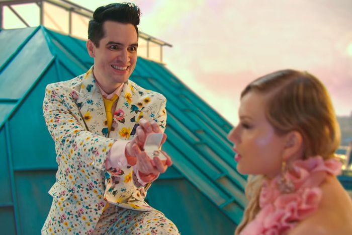 Brandon Urie presenting Taylor Swift with a ring in