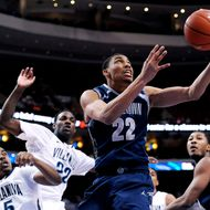 Georgetown's Otto Porter Jr. (22) drives past Villanova's Tony Chennault (5) and JayVaughn Pinkston (22) during the first half of an NCAA college basketball game, Wednesday, March 6, 2013, in Philadelphia.