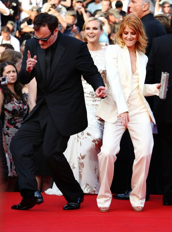 CANNES, FRANCE - MAY 20:  Director Quentin Tarantino dances with actress Melanie Laurent at the Inglourious Basterds Premiere held at the Palais Des Festivals during the 62nd International Cannes Film Festival on May 20th, 2009 in Cannes, France.  (Photo by Gareth Cattermole/Getty Images) *** Local Caption *** Quentin Tarantino;Melanie Laurent