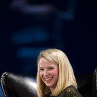 Marissa Mayer, president and chief executive officer of Yahoo! Inc., reacts during the DreamForce Conference in San Francisco, California, U.S., on Tuesday, Nov. 19, 2013. Yahoo boosted its stock-buyback plan by $5 billion, returning more cash to shareholders as Mayer seeks to revive growth at the largest U.S. Internet portal.
