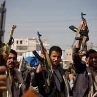 Houthi Shiite Yemeni hold their weapons during clashes in near the presidential palace in Sanaa, Yemen, Monday, Jan. 19, 2015. Rebel Shiite Houthis battled soldiers near Yemen's presidential palace and elsewhere across the capital Monday, despite a claim of a cease-fire being reached to halt the violence, witnesses and officials said. (AP Photo/Hani Mohammed)