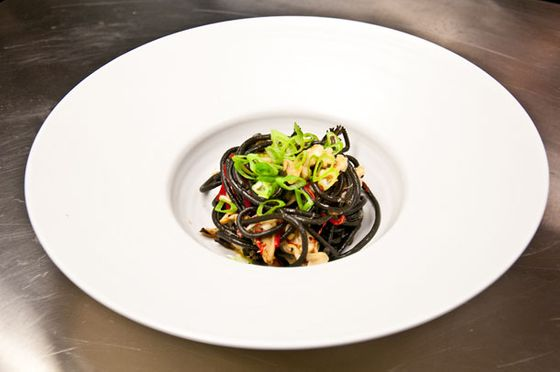 Bucatini with black garlic, snow crab, maitake, and chilies.