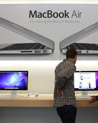 SAN FRANCISCO, CA - MAY 09: An Apple Store employee helps a customer at an Apple Store following an announcement that Apple has become the world's most valuable brand on May 9, 2011 in San Francisco, California. In a report released by London based Millward Brown, Apple Inc. has surpassed Google to claim the top spot in a global ranking of brand value this year with an estimated value of more than $153 billion up 84 percent from last year. (Photo by Justin Sullivan/Getty Images)