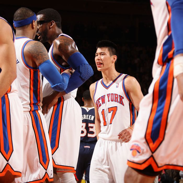 NEW YORK, NY - FEBRUARY 22: Jeremy Lin #17 of the New York Knicks reacts to the game action as he walks back to the bench against the Atlanta Hawks on February 22, 2012 at Madison Square Garden in New York City. NOTE TO USER: User expressly acknowledges and agrees that, by downloading and or using this photograph, User is consenting to the terms and conditions of the Getty Images License Agreement. Mandatory Copyright Notice: Copyright 2012 NBAE (Photo by Nathaniel S. Butler/NBAE via Getty Images)