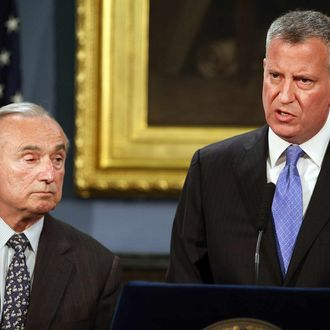 NEW YORK, NY - JULY 18: New York Mayor Bill de Blasio (right) and New York Police Commissioner William Bratton speak to the media at a news conference to address the recent death of a man in police custody on July 18, 2014 in New York City. The mayor has promised a full investigation into the circumstances surrounding the death of Eric Garner after he was taken into police custody in Staten Island yesterday. A 400-pound, 6-foot-4 asthmatic, Garner (43) died after police put him in a chokehold outside of a conveinence store for illegally selling cigarettes. (Photo by Spencer Platt/Getty Images)