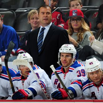 Alain Vigneault of the New York Rangers looks on during the first period of a preseason game against the New Jersey Devils on September 16, 2013 at the Prudential Center in Newark, New Jersey.