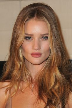 Actress Rosie Huntington-Whiteley arrives at the launch of Burberry's new frangrance.