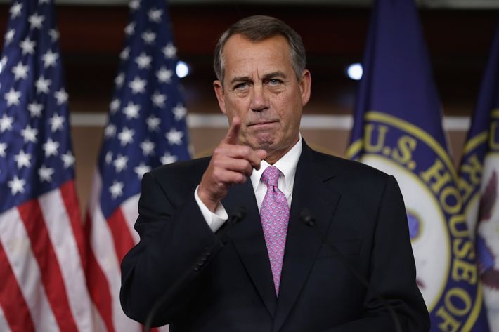 """WASHINGTON, DC - DECEMBER 05:  Speaker of the House John Boehner (R-OH) answers reporters questions during his weekly news conference in the Capitol Visitors Center at the U.S. Capitol December 5, 2013 in Washington, DC. When asked about the Republican Party's running against women, Boehner said, """"Some of our members just are not as sensitive as they ought to be.""""  (Photo by Chip Somodevilla/Getty Images)"""