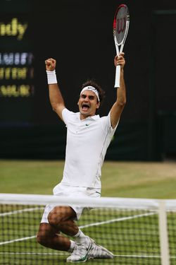 LONDON, ENGLAND - JULY 08: Roger Federer of Switzerland celebrates match point during his Gentlemen's Singles final match against Andy Murray of Great Britain on day thirteen of the Wimbledon Lawn Tennis Championships at the All England Lawn Tennis and Croquet Club on July 8, 2012 in London, England. (Photo by Julian Finney/Getty Images)