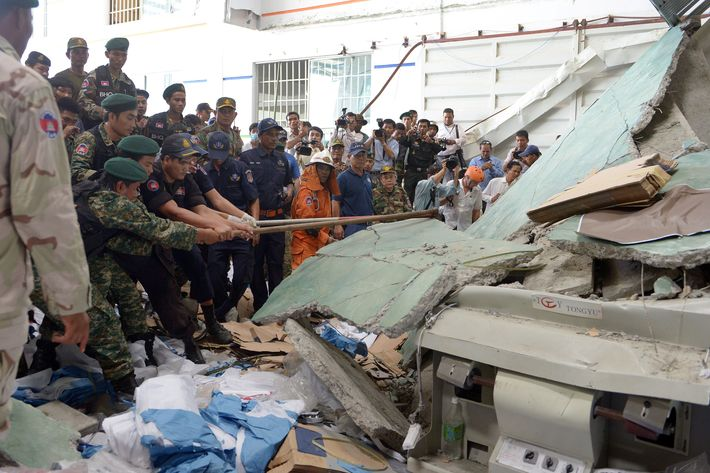 Cambodian soldiers try to move concrete after a factory collapsed in Kampong Speu province, some 50 kilometers west of Phnom Penh on May 16, 2013. A ceiling collapsed at a shoe factory in Cambodia on May 16 killing at least two workers, police said, stoking concerns about industrial safety after last month's disaster in Bangladesh.