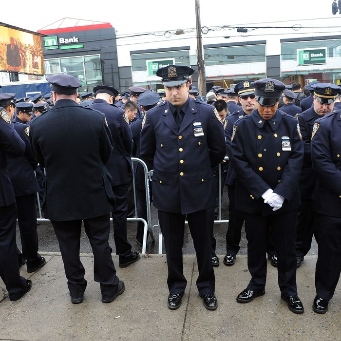 NYPD officers turn their backs on Mayor Bill de Blasio at the funeral for Officer Weijian Liu, 2014.