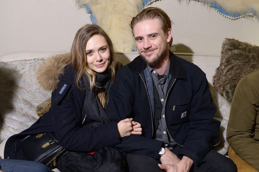 "Actors Elizabeth Olsen (L) and Boyd Holbrook attend The Snow Lodge x Eveleigh ""Little Accidents"" party on January 22, 2014 in Park City, Utah."