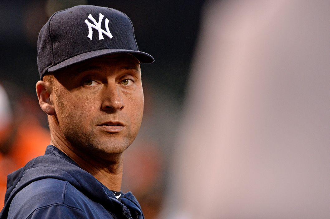 BALTIMORE, MD - SEPTEMBER 10: Derek Jeter #2 of the New York Yankees looks on from the dugout during an MLB game between the Baltimore Orioles and the New York Yankees at Oriole Park at Camden Yards on September 10, 2013 in Baltimore, Maryland.(Photo by Patrick Smith/Getty Images)