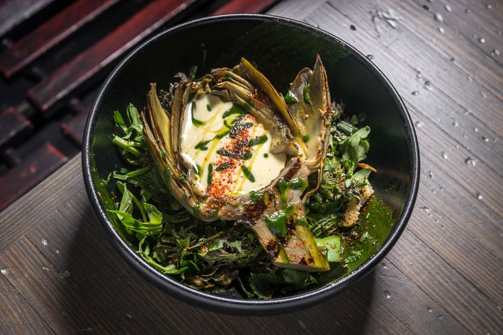 Wood-oven-roasted artichoke with lemon aioli, spring greens, and mint.
