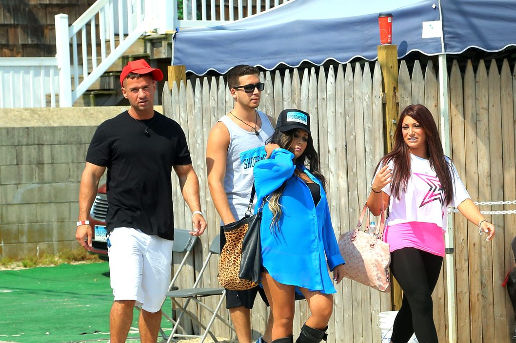 These are the finnal days of the 'Jersey Shore' original cast going to work together in Seaside Heights, New Jersey. The entire cast was spotted going to and from their job at the Shore Store as they wrap up Season Six, while their co-star Snooki is pregnant with her first child. The cast looked to have smiles on their faces as they were photographed walking for the final times on the boardwalk they helped make famous over the last 6 seasons together as fans watched them.