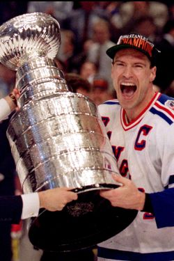New York Rangers Mark Messier holds the Stanley Cup after winning the NHL championship in June 1994. REUTERS/Gary Hershorn  CMC