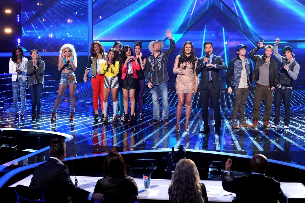 "Hosts Khloe Kardashian and Mario Lopez (C) and contestants (L-R) Diamond White, Carly Rose Sonenclar, CeCe Frey, Fifth Harmony, Tate Stevens and Emblem3 onstage at FOX's ""The X Factor"" Season 2 Top 6 Live Performance Show on December 5, 2012 in Hollywood, California."