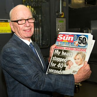 BROXBOURNE, UNITED KINGDOM - FEBRUARY 25: (EDITORS NOTE: THIS IMAGE IS FREE FOR USE UNTIL MARCH 3 2012) In this handout photograph provided by News International, Rupert Murdoch, Chairman and CEO of News Corporation, reviews the first edition of The Sun On Sunday as it comes off the presses on February 25, 2012 in Broxbourne, England. Around 3 million copies of 'The Sun On Sunday', the first ever Sunday edition of News Corporation's daily newspaper 'The Sun', are due to go on sale on Sunday February 26, 2012. (Photo by Arthur Edwards/News International via etty Images)