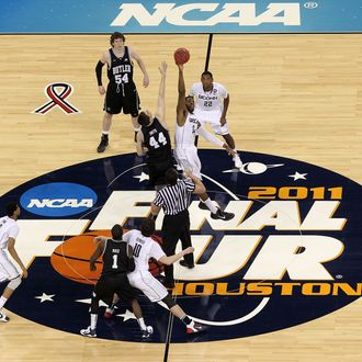 HOUSTON, TX - APRIL 04: Andrew Smith #44 of the Butler Bulldogs tips the ball off against Alex Oriakhi #34 of the Connecticut Huskies to start the National Championship Game of the 2011 NCAA Division I Men's Basketball Tournament at Reliant Stadium on April 4, 2011 in Houston, Texas. (Photo by Andy Lyons/Getty Images) *** Local Caption *** Andrew Smith; Alex Oriakhi