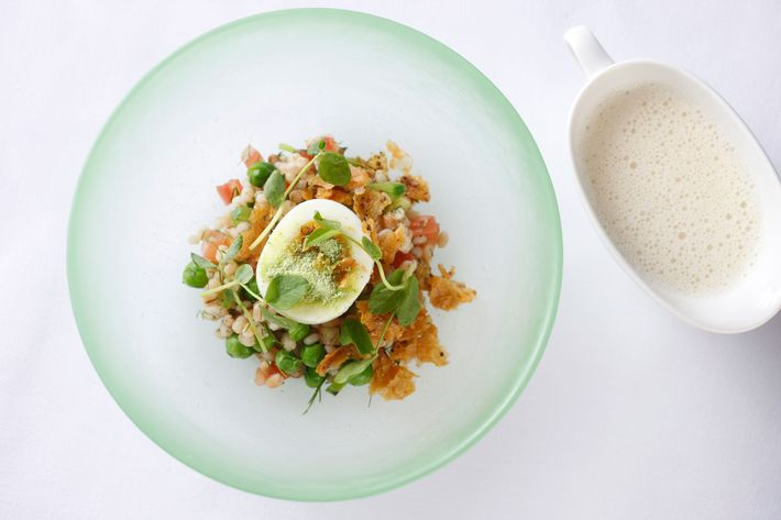 Soft-boiled egg, chicken cracklings, sugar snap peas, and barley.