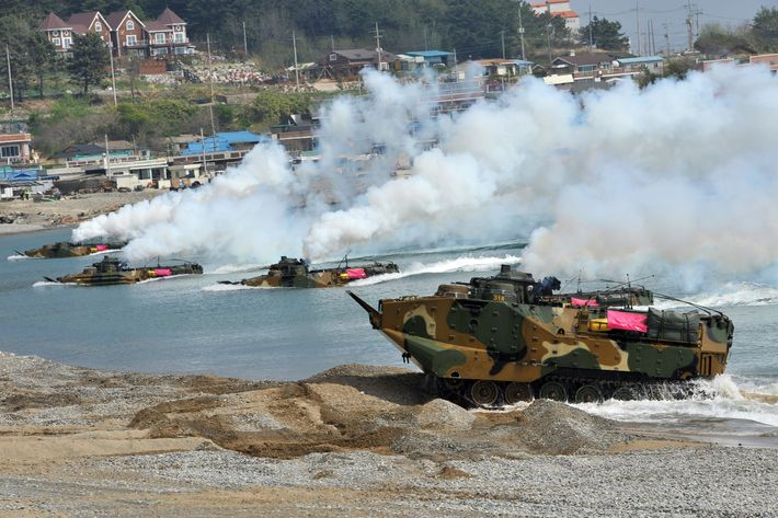 South Korean Marine amphibious assault vehicles land on the seashore during a joint landing operation by US and South Korean Marines in Pohang, 270 kms southeast of Seoul, on April 26, 2013. The US and South Korea staged a military landing exercise as the Korean peninsula was already engulfed in a cycle of escalating tensions triggered by the North Korea's nuclear test in February. AFP PHOTO / JUNG YEON-JE (Photo credit should read JUNG YEON-JE/AFP/Getty Images)