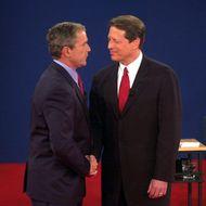 Republican presidential nominee George W. Bush (L)