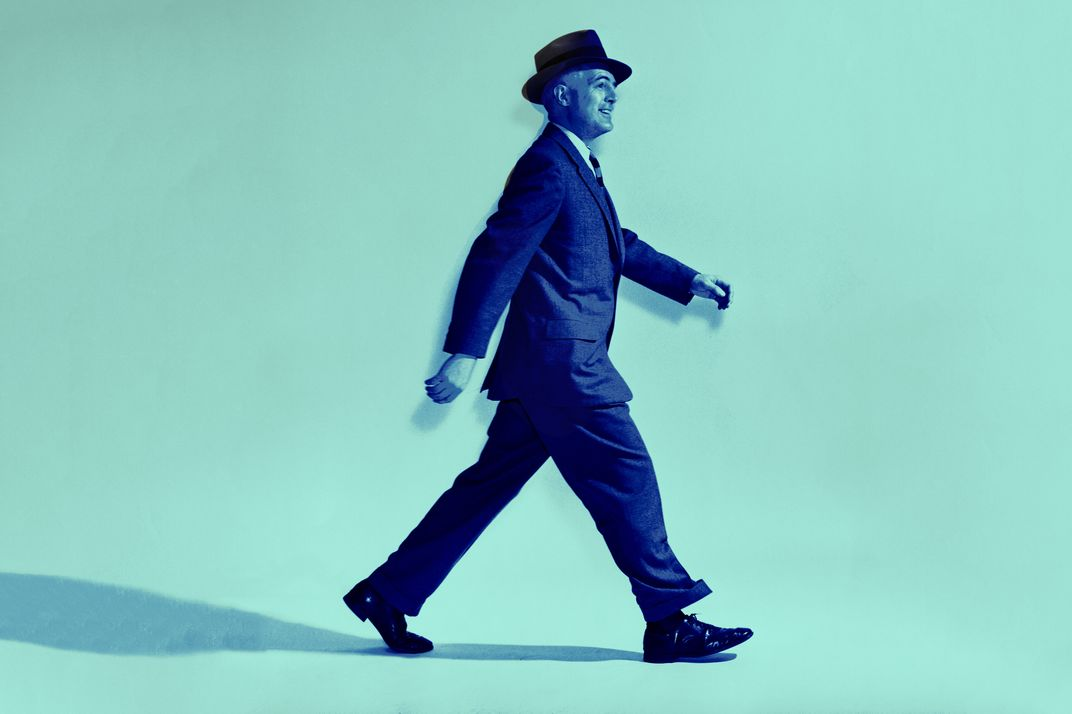 Side profile of businessman walking