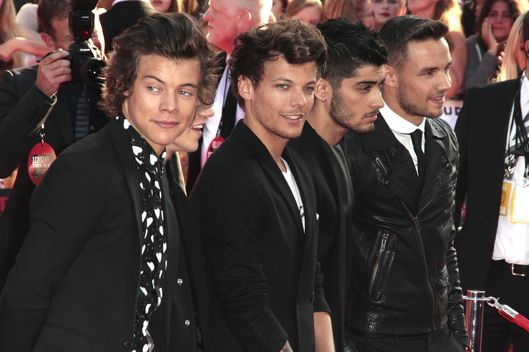 "London, United Kingdom. 20th August 2013 -- One Direction members Harry Styles, Niall Horan, Louis Tomlinson, Zayn Malik and Liam Payne at the ""One Direction: This is Us"" premiere in London. -- Celebrities joined the boys from One Direction on the red carpet for the World Premiere of their new film, ""One Direction: This Is US at the Empire"", Leicester Square, London."