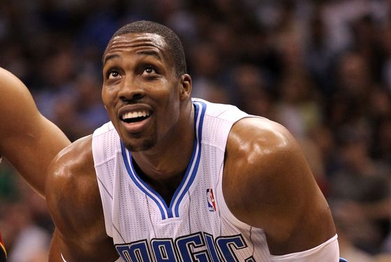Dwight Howard #12 of the Orlando Magic smiles during the game against the Miami Heat at Amway Center on March 13, 2012 in Orlando, Florida.