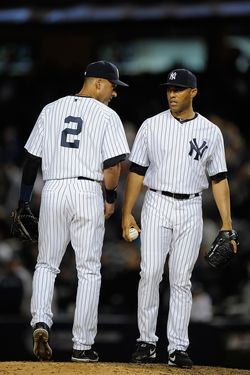 NEW YORK, NY - OCTOBER 01:  Mariano Rivera #42 of the New York Yankees talks with Derek Jeter #2 in the ninth inning against the Detroit Tigers during Game One of the American League Division Series at Yankee Stadium on October 1, 2011 in the Bronx borough of New York City.  (Photo by Patrick McDermott/Getty Images)