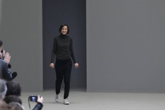 British designer Phoebe Philo acknowledges the public following the Celine Autumn/Winter 2011-2012 ready-to-wear collection show on March 6, 2011 in Paris.