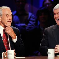 HANOVER, NH - OCTOBER 11:  U.S. Rep. Ron Paul (R-TX) listens while former U.S. Speaker of the House Newt Gingrich laughs during a presidential debate hosted by Bloomberg and the Washington Post on October 11, 2011 at Dartmouth College in Hanover, New Hampshire. The event moderated by U.S. television talk show host Charlie Rose and featuring eight Republican candidates, presents the first debate of the 2012 political season focused solely on the economy. (Photo by Scott Eells-Pool/Getty Images)