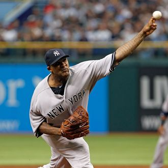 Pitcher CC Sabathia #52 of the New York Yankees pitches against the Tampa Bay Rays
