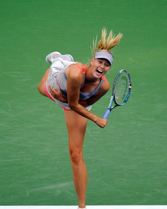 NEW YORK, NY - AUGUST 29: Maria Sharapova of Russia serves the ball against Heather Watson of Great Britian during Day One of the 2011 US Open at the USTA Billie Jean King National Tennis Center on August 29, 2011 in the Flushing neighborhood of the Queens borough of New York City. (Photo by Patrick McDermott/Getty Images)