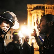 Protesters face off following a Staten Island, New York grand jury's decision not to indict a police officer in the chokehold death of Eric Garner on December 3, 2014 in Oakland, California.