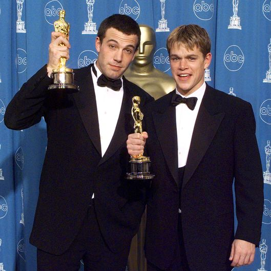 "Matt Damon (R) and Ben Affleck (L) pose with their Oscars they won for Best Original Screenplay for ""Good Will Hunting"" 23 March at the 70th Annual Academy Awards at the Shrine Auditorium in Los Angeles."