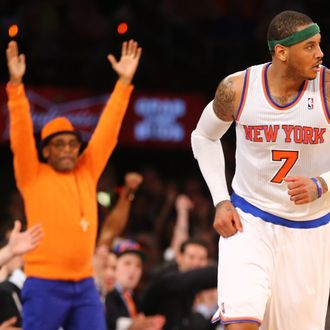 NEW YORK, NY - APRIL 09: Director Spike Lee celebrates a basket by Carmelo Anthony #7 of the New York Knicks during their game against the Washington Wizards at Madison Square Garden on April 9, 2013 in New York City. NOTE TO USER: User expressly acknowledges and agrees that, by downloading and or using this photograph, User is consenting to the terms and conditions of the Getty Images License Agreement. (Photo by Al Bello/Getty Images)