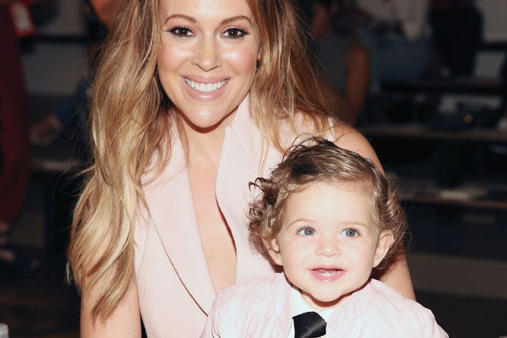 Alyssa Milano's baby had a better seat than most adults.