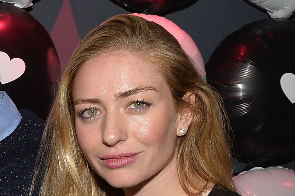 Whitney Wolfe VP Marketing Tinder, attends a party to celebrate Glamour Hearts Tinder hosted by Glamour Magazine and Tinder at Chateau Marmont's Bar Marmont on February 3, 2014 in Hollywood, California.