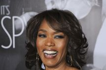 "Actress Angela Bassett arrives at the Los Angeles premiere of ""This Means War,"" at Grauman's Chinese Theater in Hollywood, California, February 8, 2012.  AFP PHOTO / Robyn Beck (Photo credit should read ROBYN BECK/AFP/Getty Images)"