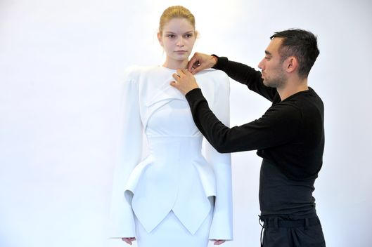 Nicola Formichetti prepares for his Thierry Mugler fall 2012 runway show.
