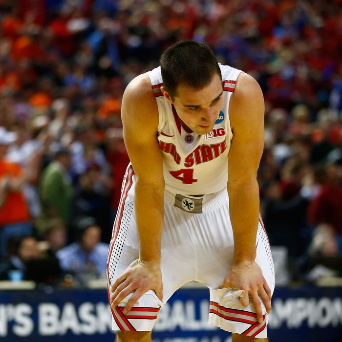 Aaron Craft #4 of the Ohio State Buckeyes reacts after losing to the Dayton Flyers 60-59 in the second round of the 2014 NCAA Men's Basketball Tournament at the First Niagara Center on March 20, 2014 in Buffalo, New York.