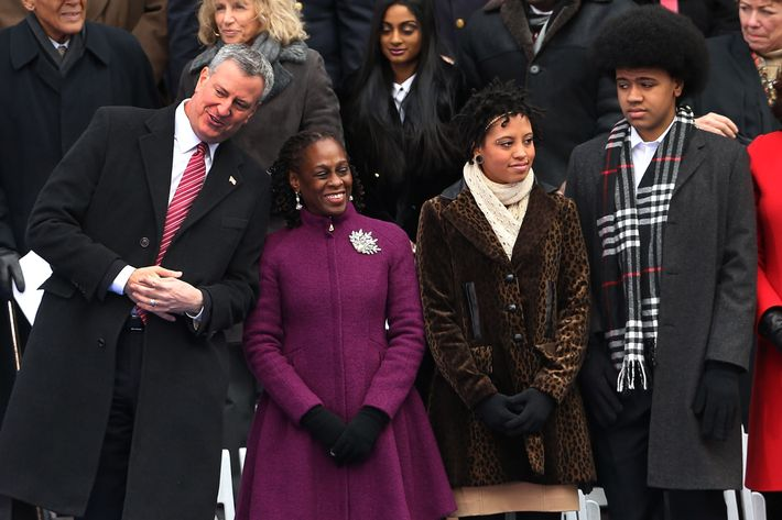 New York City's 109th Mayor Bill de Blasio stands on stage with his family Chiara de Blasio (center) Dante de Blasio (right) and wife Chirlane McCray (left) at City Hall on January 1, 2014 in New York City. Mayor de Blasio was sworn in using a Bible once owned by President Franklin Delano Roosevelt. Following the 12 years of the Michael Bloomberg administration, Mayor de Blasio won on a liberal platform that emphasized the growing gulf between the rich and poor in New York City.