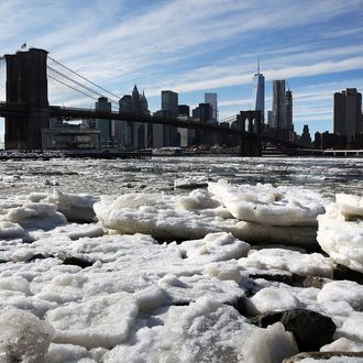 A build-up of ice is viewed in the East River near the Brooklyn Bridge on February 23, 2015 in New York City. New York City and much of the East Coast has been experiencing frigid temperatures over the past week with heavy snow and sleet accumulations. Temperatures have hovered in the teens with wind chills dropping below zero.(Photo by Spencer Platt/Getty Images)